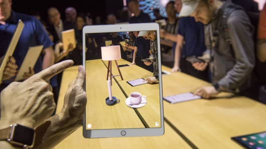 An attendee demonstrates the ARKit, augmented reality tool, on an Apple Inc. iPad Pro during the Apple Worldwide Developers Conference (WWDC) in San Jose, California, U.S., on Monday, June 5, 2017.