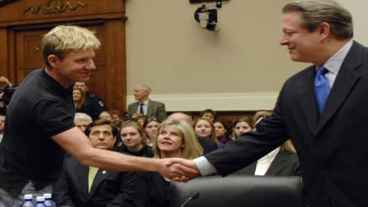 Dr. Buorn Lomborg, director of the Copenhagen Consensus Center testifies on global warming evidence along with former Vice President Al Gore. The two shake hands prior to the beginning of the testimony as Tipper Gore looks on..