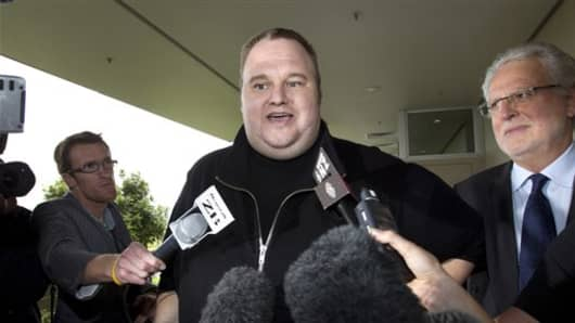 FILE - In this Feb. 22, 2012 file photo, Kim Dotcom, the founder of the file-sharing website Megaupload, comments after he was granted bail and released in Auckland, New Zealand. In the eyes of New Zealand immigration authorities in 2010, Kim Dotcom's money trumped his criminal past. Documents released to The Associated Press this week under New Zealand public records laws show that immigration officials granted the Megaupload founder residency that year after deciding the money he could bring t