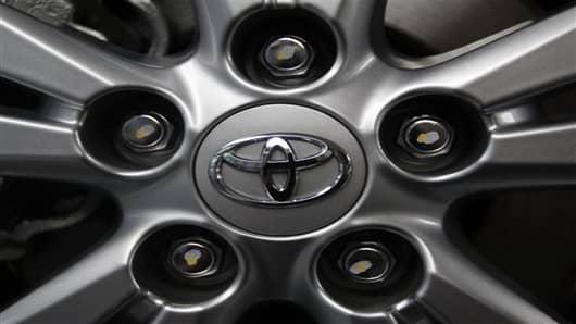 Toyota Motor's logo is seen on a tire wheel of an Avensis sedan.