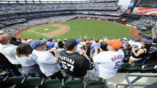 FILE- In tis April 5, 2010, file photo, New York Mets' fans celebrate after the Mets' David Wright hit a two-run home run in the first inning of a baseball game against the Florida Marlins at Citi Field in New York.  A person familiar with the announcement says Major League Baseball will announce Wednesday, May 16, 2012, that the New York Mets will host the 2013 All-Star game at Citi Field. The person spoke on condition of anonymity on Tuesday, May 15, because MLB did not reveal the purpose of W