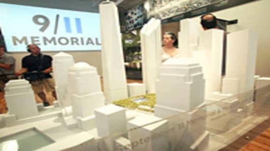 Visitors view a model of the World Trade Center site on the opening day of the 9/11 Memorial Preview Site near the World Trade Center in New York City.