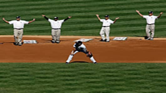 The New York Yankees grounds crew dances to the YMCA during the game against the Baltimore Orioles at Yankee Stadium.