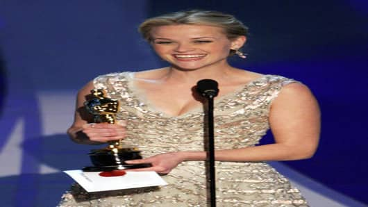 "**EMBARGOED AT THE REQUEST OF THE MOTION PICTURE ACADEMY FOR USE UPON CONCLUSION OF THE ACADEMY AWARDS TELECAST** Actress Reese Witherspoon accepts the Oscar for best actress for her work in ""Walk the Line"" at the 78th Academy Awards Sunday, March 5, 2006, in Los Angeles. (AP Photo/Mark J. Terrill)"