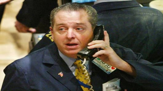 ** FILE **Specialist Michael Hayward works on the floor of the New York Stock Exchange in this Jan. 29, 2003, file photo. The Securities and Exchange Commission charged 15 specialists, including Hayward, on Tuesday, April 12, 2005 with using their inside positions to earn illicit gains for themselves and their firms. (AP Photo/David Karp, File)
