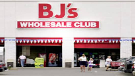 Shoppers are seen outside BJ's Wholesale Club in Stoneham, MassachusettsMassachussets.