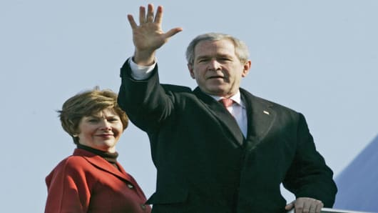 President Bush, right, accompanied by first lady Laura Bush, waves prior to boarding Air Force One at Andrews Air Force Base in Maryland, Thursday, March 8, 2007, before their departure to Latin America. (AP Photo/Pablo Martinez Monsivais)