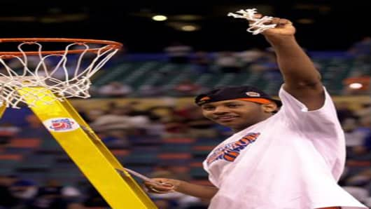 Syracuse's Carmelo Anthony cuts off a piece of the net after winning the championship game 81-78 against Kansas at the Final Four Monday, April 7, 2003, in New Orleans. Anthony was named the tournament MVP. (AP Photo/Ed Reinke)