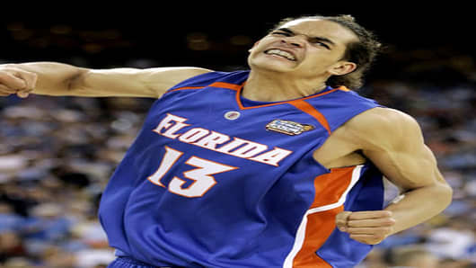 Florida's Joakim Noah celebrates during the second half of the Gators' 73-57 win over UCLA inf the Final Four national championship basketball game in Indianapolis, Monday, April 3, 2006.  (AP Photo/Michael Conroy)