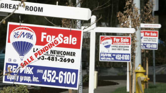 For sale signs line the street in a complex of new homes in Beaverton, Ore., Wednesday, Feb. 28, 2007.  New-home sales plunged in January by the largest amount in 13 years. (AP Photo/Don Ryan)