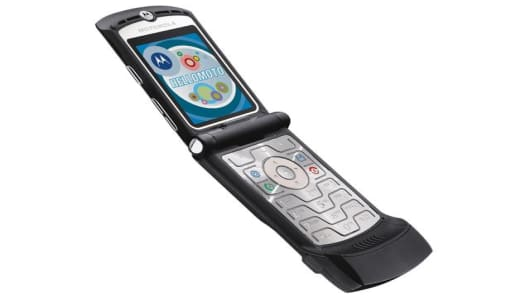 A photo provided by Motorola Inc., shows the new black version of its popular Razr V3 cellular phone. On Tuesday, July 19, 2005, the Schaumburg, Ill.-based Motorola bettered Wall Street's expectations by reporting second-quarter profits of $933 million, reflecting continuing strong sales of its Razr and other new products. (AP Photo/Motorola Inc.)