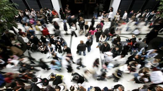 Thousands of people make their way through different stores, while taking in the annual Boxing Day sales on Tuesday, Dec. 26, 2006 at a mall in Toronto. (AP PHOTO/Nathan Denette, CP)
