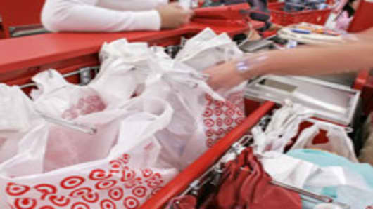 Shoppers check out at a newly-opened Target store near Royersford, Pa., on Monday, Nov. 13, 2006. Discount retailer Target Corp. said Tuesday its third-quarter profit rose 16 percent, beating analyst expectations as its sales rose 11 percent. (AP Photo/George Widman)