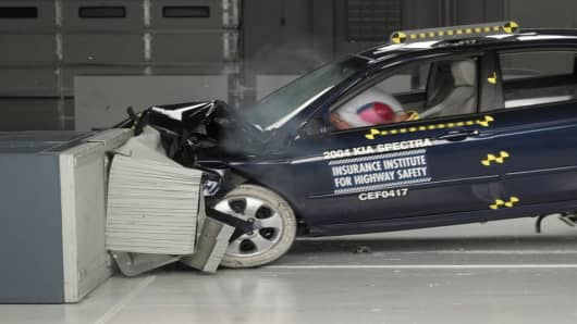 Photo released by the Insurance Institute for Highway Safety shows a crash test of a 2004-05 Kia Spectra, manufactured after November 2003. (AP Photo/ Insurance Institute for Highway Safety)