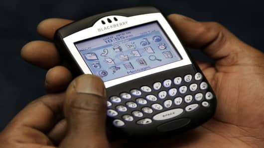 A Blackberry devise is used on Capitol Hill in Washington, Wednesday, April 18, 2007. (AP Photo/Susan Walsh)