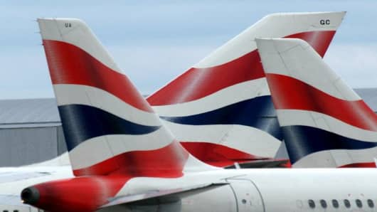 British Airways planes are parked on the apron of terminal 4 at London's Heathrow airport
