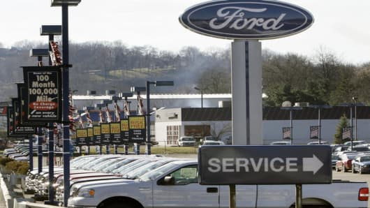 A line of Ford trucks sit at a Ford dealership in Castle Shannon, Pa.,  Wednesday, Jan. 3, 2007. Ford held off Toyota as the No. 2 U.S. vehicle seller in December despite a nearly 13 percent sales drop compared with a year ago.  (AP Photo/Gene J. Puskar)