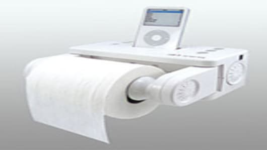 Outsourcing The News On A New Level - Icarta-ipod-dock-and-toilet-roll-dispenser