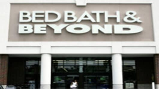 A shopper leaves the Bed Bath & Beyond store in Ellisville, Mo.