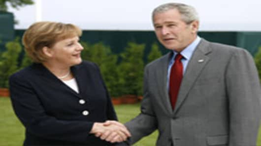 U.S. President George Bush, right, greets German Chancellor Angela Merkel during the G8 summit in Heiligendamm, Germany on Wednesday, June 6, 2007.The leaders of the G8 nations hold their annual summit in the historic Heiligendamm sea resort near Rostock, Germany, on June 6-8, 2007 (AP Photo/Herbert Knosowski)