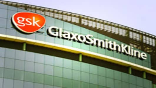 The company logo of GlaxoSmithKline, is seen on the headquarters building in London, Wednesday May 10, 2006. GlaxoSmithKline PLC said Wednesday it has been granted a High Court injunction against animal rights activists who sent threats to the drugmaker's shareholders, barring them from sending more letters or revealing private information about the investors. (AP Photo/Alastair Grant)