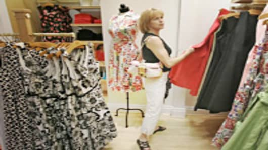 Judy Sved of Pittsburgh shops in the Talbots at the Galleria in Mt. Lebanon, Pa., Tuesday, May 8. 2007. U.S. retailers are releasing their April sales figures on Thursday May 10, 2007. (AP Photo/Gene J. Puskar)