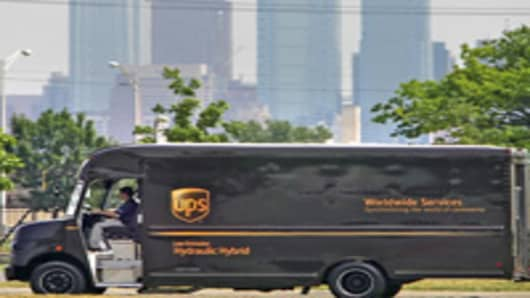 A hydraulic hybrid UPS delivery truck is seen with the Philadelphia skyline in the background during a demonstration in Philadelphia, on Friday, June 23, 2006. The UPS truck uses an Environmental Protection Agency patented hydraulic hybrid technology that the EPA claims will increase fuel efficiency by 60 to 70 percent. Full hydraulic hybrid technology means that the conventional transmission and transfer case have been removed and replaced with a hydraulic drivetrain. (AP Photo/Matt Rourke)