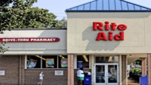 Customers walk around the exterior of the Rite Aid in Harrisburg, Pa., Thursday, Sept. 22, 2005. Rite Aid Corp. reported a second-quarter loss that reversed gains from a year ago. (AP Photo/Carolyn Kaster)