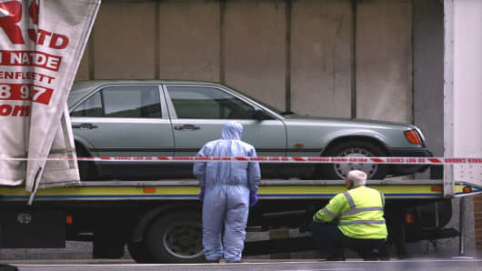 A Mercedes car is loaded onto a removals truck in Haymarket Street, near Piccadilly, central London which contain a suspected car bomb Friday, June 29, 2007. British police defused a bomb found in a parked car in central London on Friday, and the new government called an emergency meeting of senior security chiefs to investigate what many feared could have been a planned terror attack in the capital. (AP Photo/Simon Dawson)