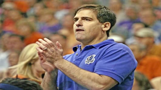 Dallas Mavericks owner Mark Cuban reacts as his team plays the Phoenix Suns in Game 3 of their NBA Western Conference finals basketball game Sunday, May 28, 2006, in Phoenix. (AP Photo/Chris Carlson)