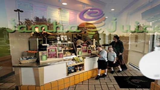 Customers wait for their order at a Jamba Juice store.
