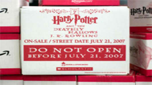 "Copies of ""Harry Potter and the Deathly Hallows,"" published by Scholastic, sit inside an Amazon.com fulfillment center."