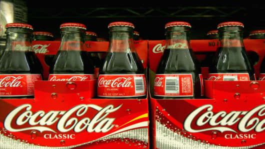 Coca-Cola bottles are displayed at Andronico's Market in San Francisco, Saturday, July 15, 2006. The Coca-Cola Co., the world's largest beverage maker, reports a 7 percent increase in second-quarter profit on a modest rise in sales.  (AP Photo/Jeff Chiu)