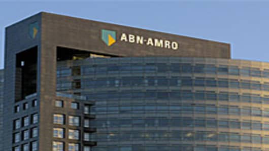 "The setting sun casts a yellow glow on the ABN Amro head office building in Amsterdam, Netherlands, Wednesday July 18, 2007. ABN Amro said Wednesday it would meet with a consortium led by Royal Bank of Scotland that is offering euro 71.1 billion (US$97.8 billion) for the Dutch bank and with rival bidder Barclays PLC to discuss ""the implications"" of the RBS bid. The target of the largest takeover battle in the history of the financial industry added that it has ""no intention of making any major a"