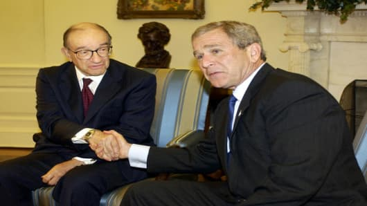 President Bush shakes hands with Federal Reserve Chairman Alan Greenspan after the two met in the Oval office at the White House Tuesday, May 18, 2004. The President renominated Greenspan as chairman of the Federal Reserve for his fifth term, praising his leadership and sending a strong signal of stability to financial markets.(AP Photo/Gerald Herbert)