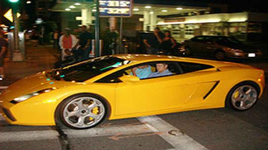 Papelbon driving a yellow Lamborghini