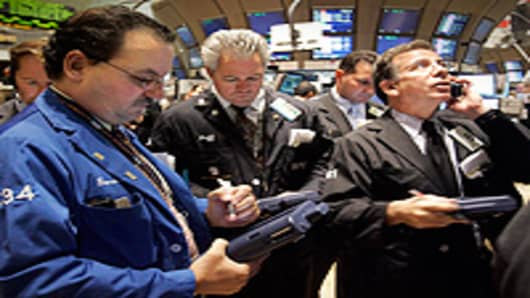 Traders work on the floor of the New York Stock Exchange.
