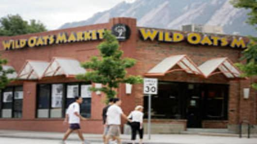 Shoppers head into a Wild Oats Market in Boulder, Colorado.