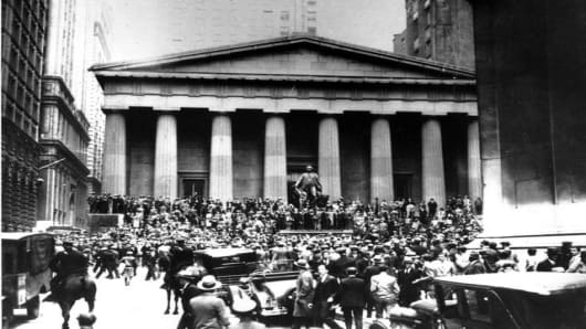 Crowds panic in the Wall Street district of Manhattan due to the heavy trading on the stock market in New York City on Oct. 24, 1929.