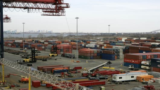 Containers are loaded and unloaded Wednesday, April 11, 2007  at the New York Container Terminal in the Staten Island borough of New York. The Director of Homeland Security's  Domestic Nuclear Detection Office Vayl Oxford toured the Advanced Spectroscopic Portals installed at the New York Container Terminal on Wednesday. (AP Photo/Frank Franklin II)