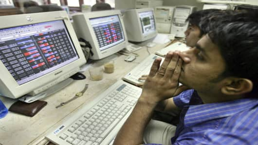 A stockbroker watches his terminal during trading in Bombay, India, Thursday, May 18, 2006. Indian shares plunged Thursday, with the benchmark stock index tumbling 6.8 percent, or more than 800 points, its biggest point drop ever, largely on fears of higher taxes on foreign funds that invest in Indian stocks. (AP Photo/Rajesh Nirgude)