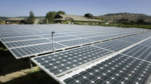 Solar panels are shown with the Frog's Leap winery in the background in Rutherford, Calif., Tuesday, Sept. 18, 2007. San Francisco-based Sunlight Electric has helped more than a dozen wineries, including Frog's Leap, to go solar. The company estimates there are 28 systems in Napa County and another 14 in next-door Sonoma County. (AP Photo/Eric Risberg)