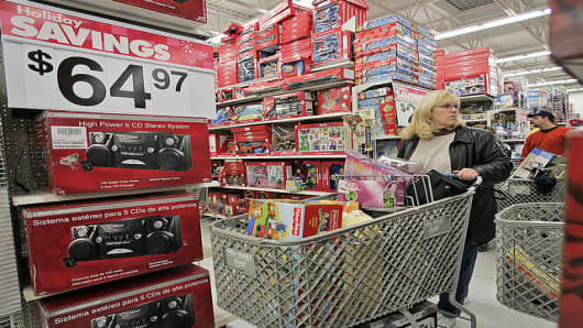 Claire Vissichelli of South Setauket pushes a shopping cart inside of a Wal-Mart in South Setauket, N.Y., shortly after the store opened at 5 a.m., Friday, Nov. 25, 2005. The nation's retailers are set to usher in the 2005 holiday shopping season with the usual come-ons_deep discounts and expanded hours_ along with a slew of stores offering early bird specials for the first time. (AP Photo/Ed Betz)