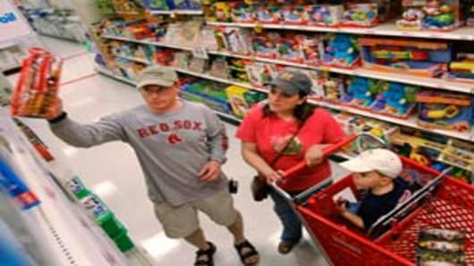 Parents shop in the toy aisle at a Target store, Kingston, Massachusetts