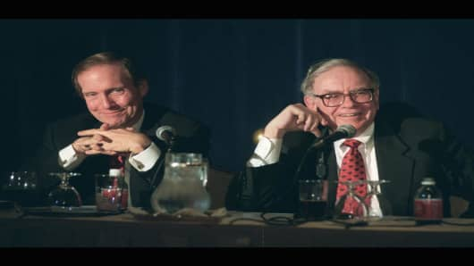 Warren Buffett, right, chairman of Berkshire Hathawy Inc., speaks to the media while Ron Ferguson, chairman and chief executive officer of General Re, listens in New York on Friday, June 19, 1998. Berkshire Hathaway Inc. is buying General Re for $22 billion worth of stock, adding one of the world's leading insurers of insurance companies to its portfolio. Berkshire announced Friday after the stock market closed that it would let General Re operate independently of its other insurance operations,