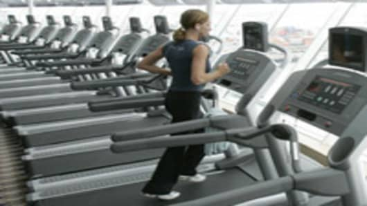 Jogger exercises on treadmill.