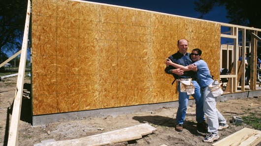 Volunteers Steve and Susan Wilson are pictured on a Habitat build site. (2003)