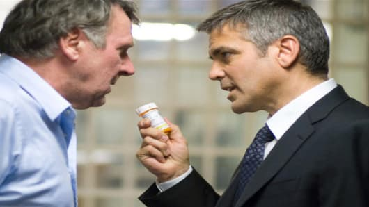 "Tom Wilkinson, left, and George Clooney are shown in a scene from ""Michael Clayton."""