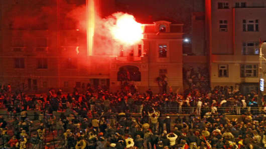 The U.S. embassy in Belgrade burns after masked attackers broke into the building and set an office on fire at the end of a massive protest against Western-backed Kosovo independence, in the Serbian capital, Thursday, Feb. 21, 2008. More than 150,000 Serbs gathered at the rally vowing to retake the territory which is viewed as Serbia's religious and national heartland.