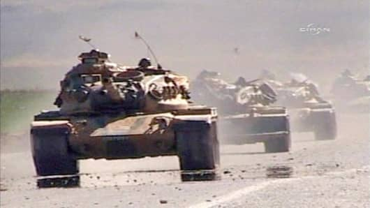 Turkish army tanks head towards border with northern Iraq, Sirnak, southeast Turkey.